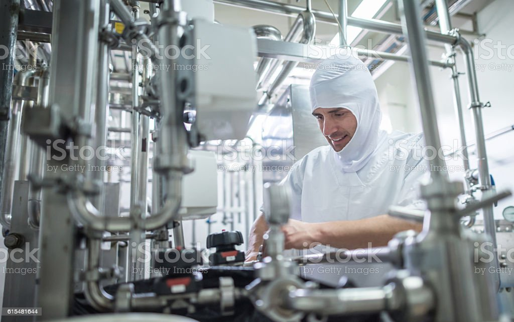 Man working at a food processing plant stock photo