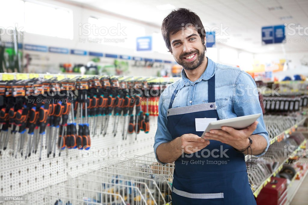 Man working at a hardware store stock photo