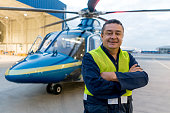 Man working at a helicopter hangar