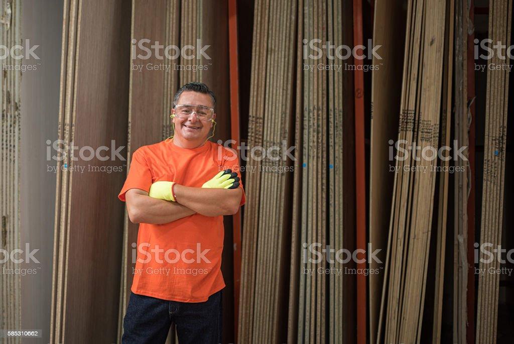 Man working at a lumberyard stock photo