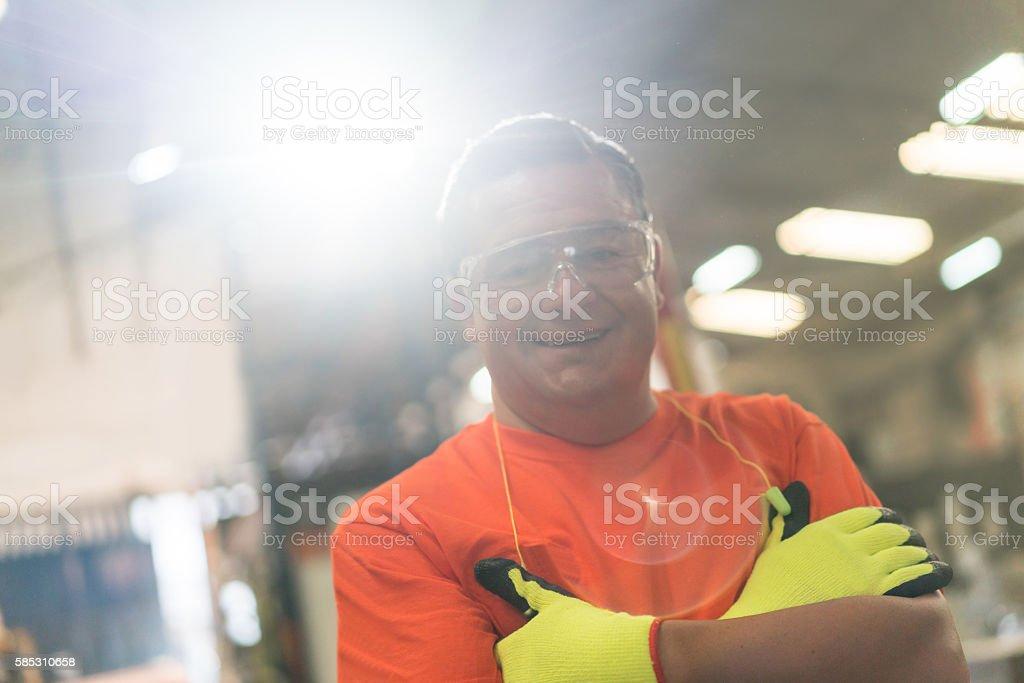 Man working at a lumberyard wearing protective wear stock photo