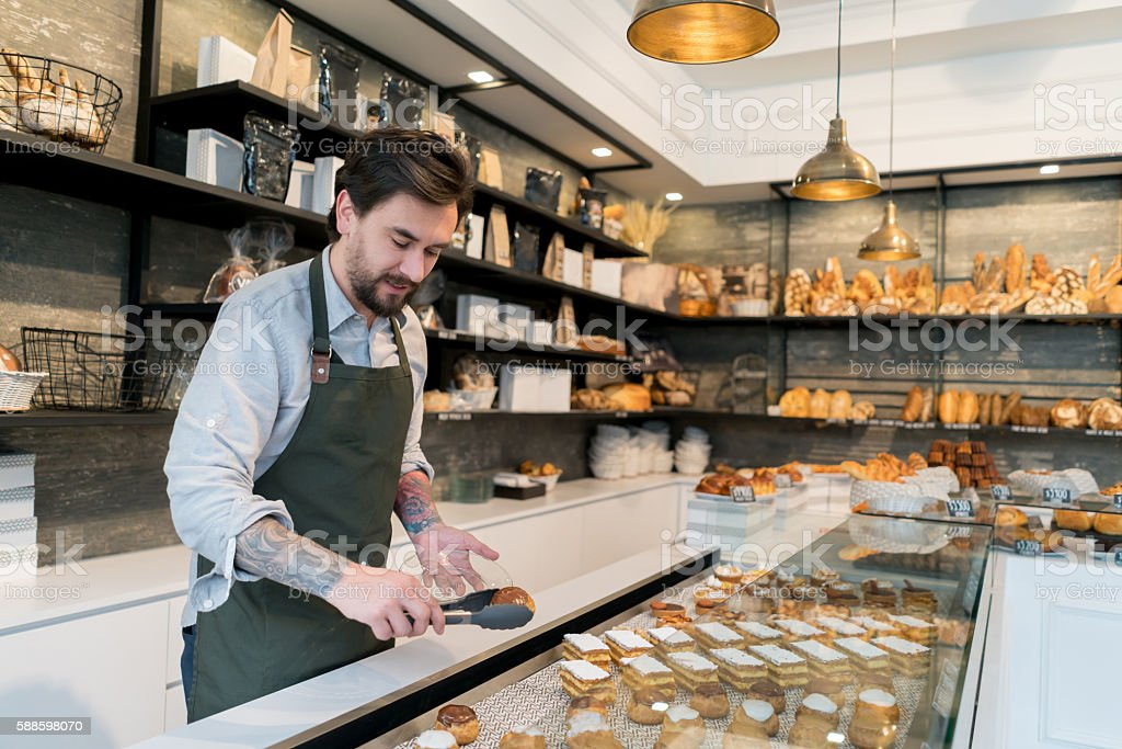 Man working at a pastry shop stock photo