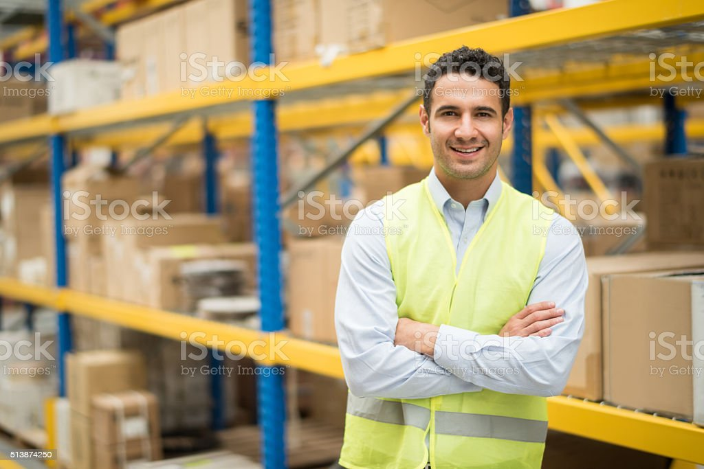Man working at a warehouse stock photo