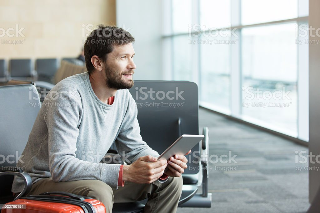 man working at airport stock photo