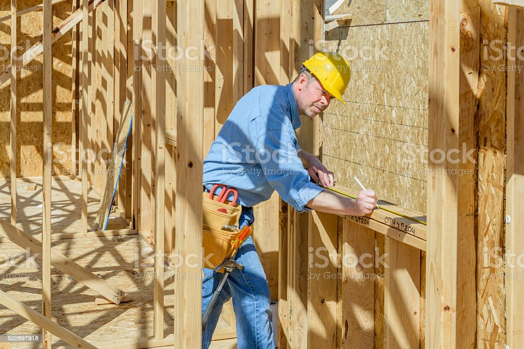 Man working at construction site. stock photo
