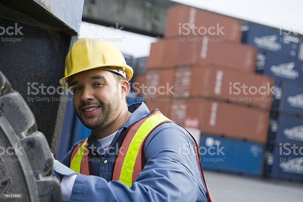 Man working at container terminal stock photo
