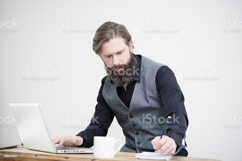 Man working at desk royalty-free stock photo