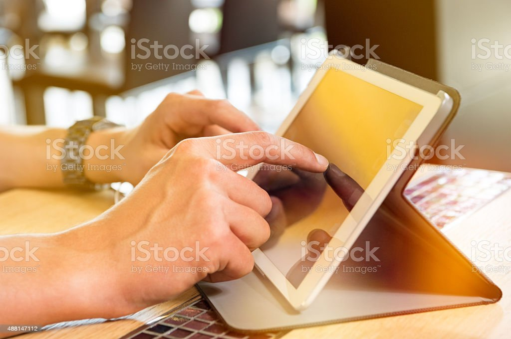 Man working at digital tablet stock photo