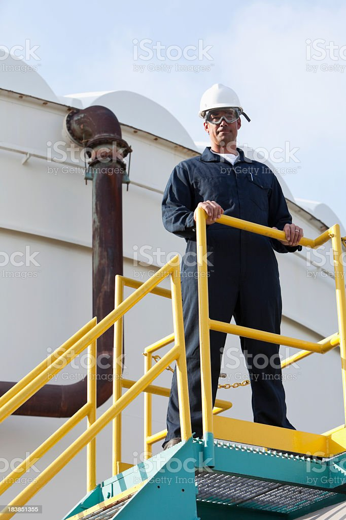 Man working at industrial plant royalty-free stock photo