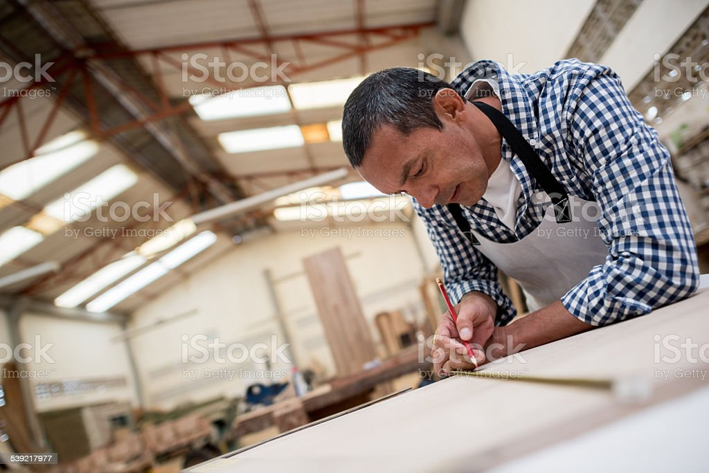 Man working at the carpentry stock photo
