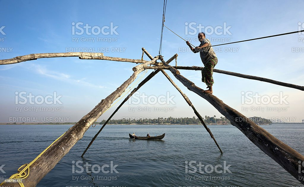 Man working Chinese Fishing Net, Cochin, Kerala, India stock photo