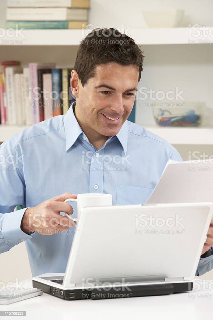 Man Working From Home Using Laptop royalty-free stock photo