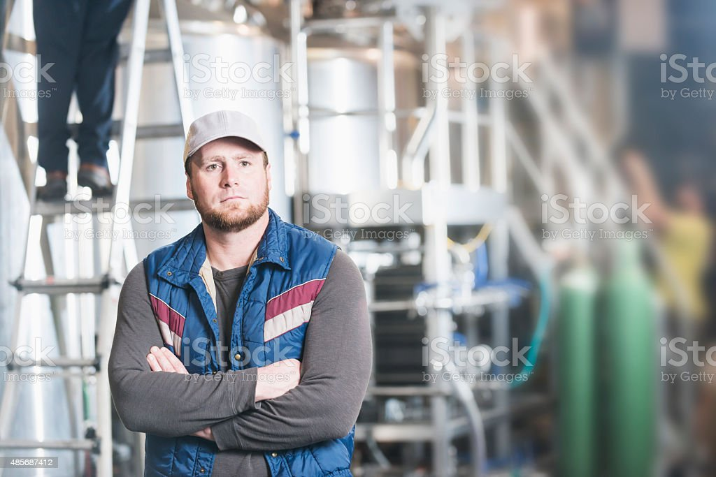 Man working in a microbrewery stock photo