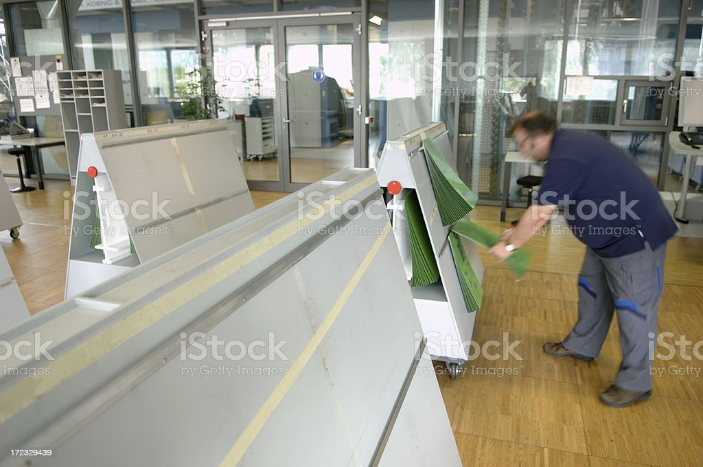 Man working in a printing office royalty-free stock photo