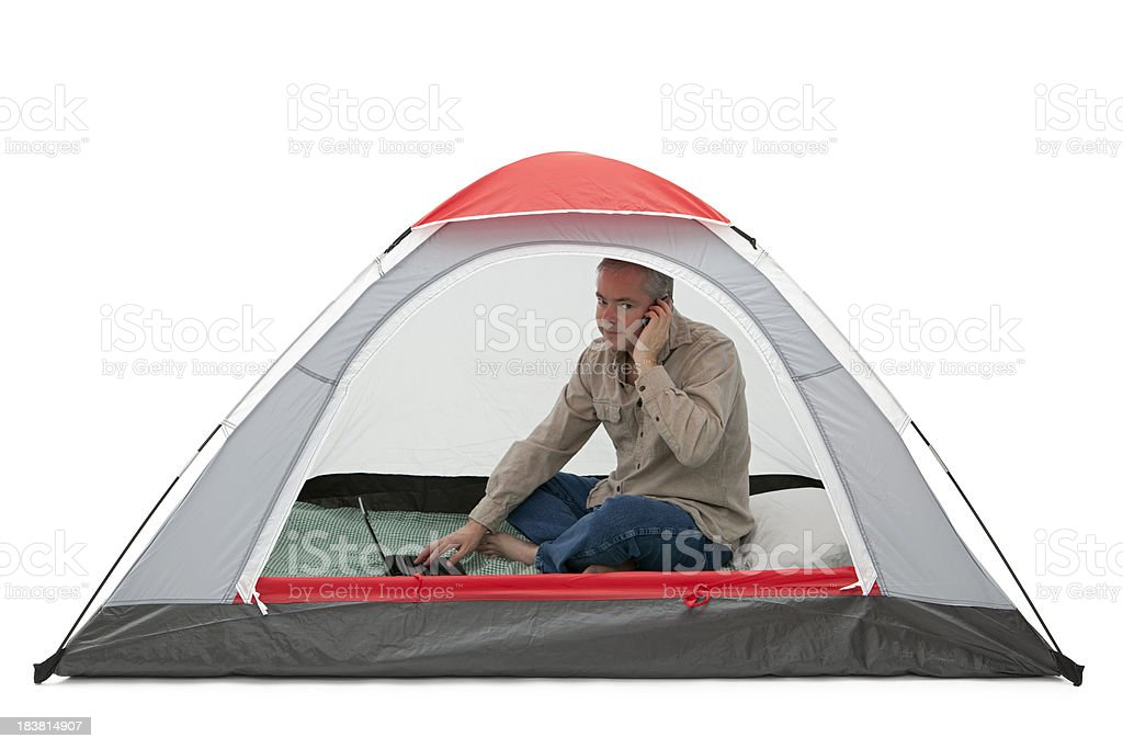 Man Working in a Tent royalty-free stock photo