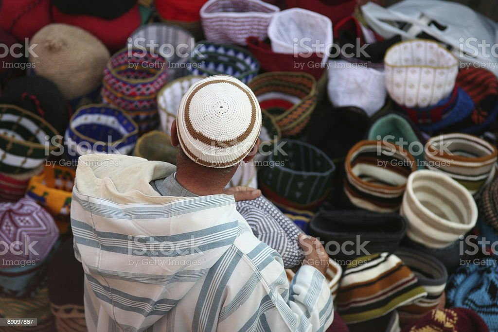 Man working in african market stock photo