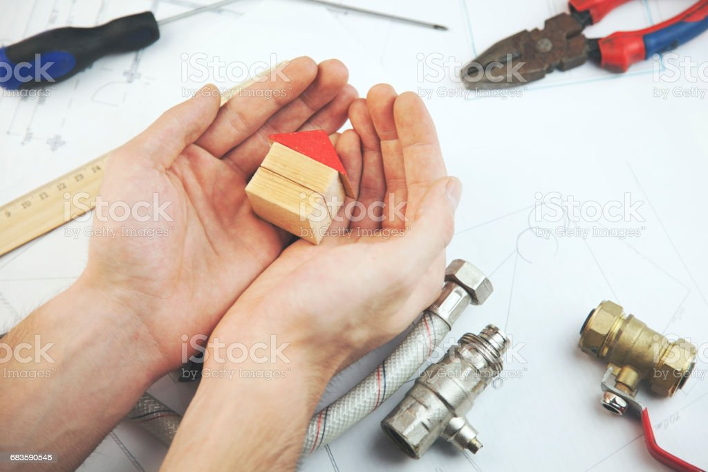 Man working in architecture.Man hand house model stock photo