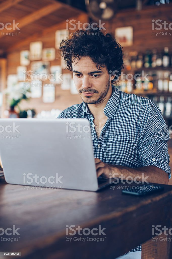 Man working in cafeteria stock photo