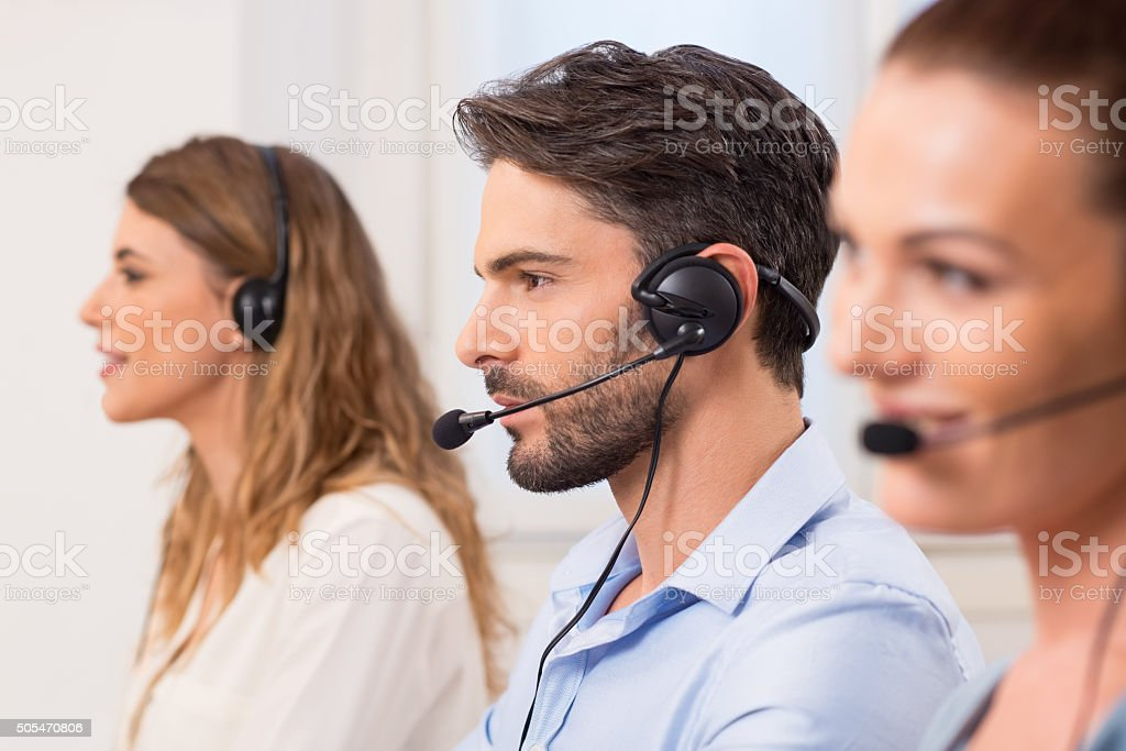 Man working in call center stock photo