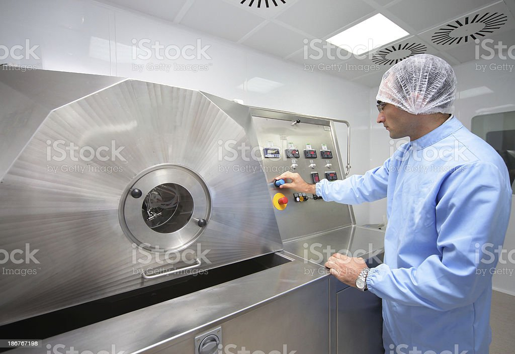 Man working in food processing factory stock photo