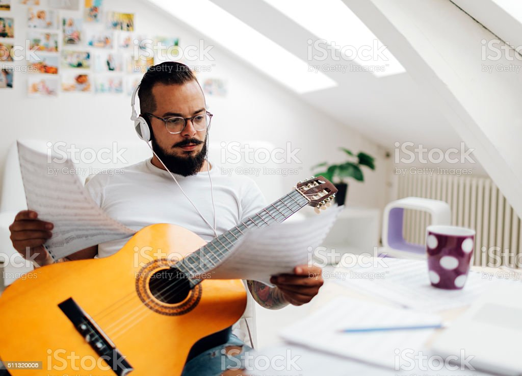 Man Working in his Recording Studio. stock photo
