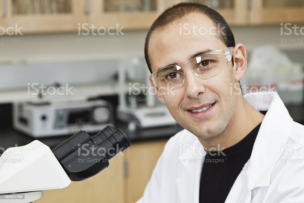 Man Working in Laboratory With Microscope royalty-free stock photo