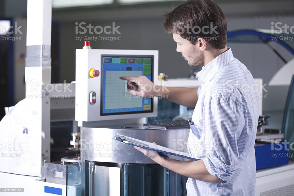 Man working in manufacturing stock photo