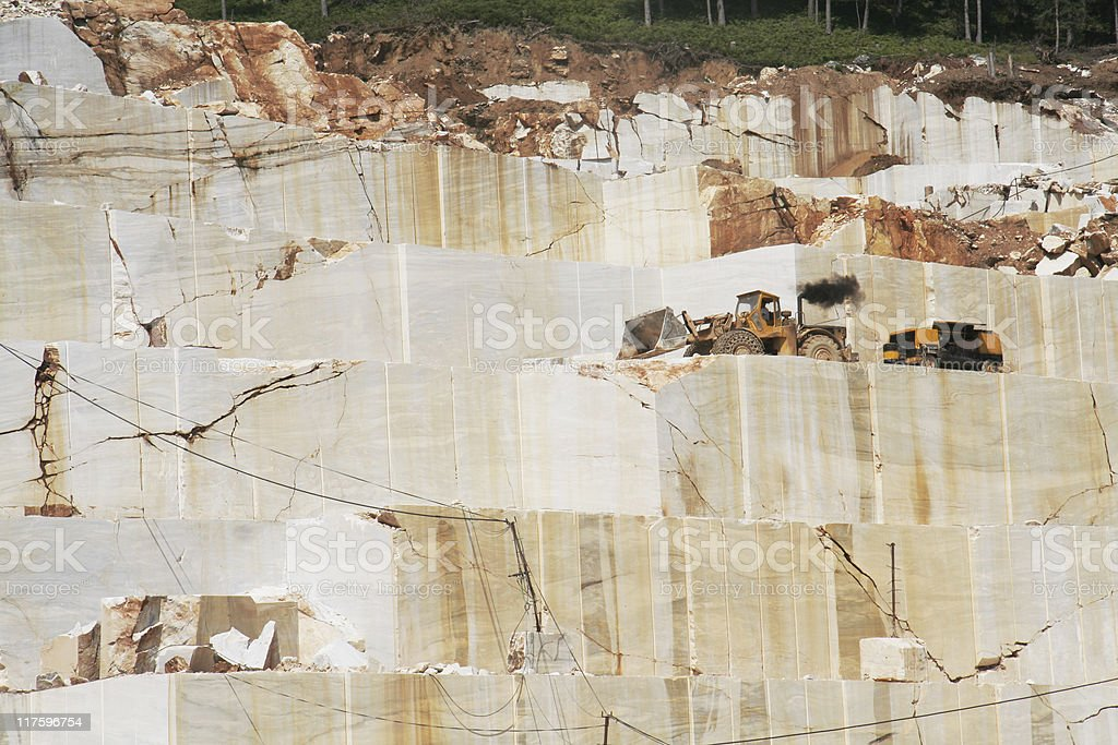 Man working in marble quarry on Greek island Thassos (Series) royalty-free stock photo
