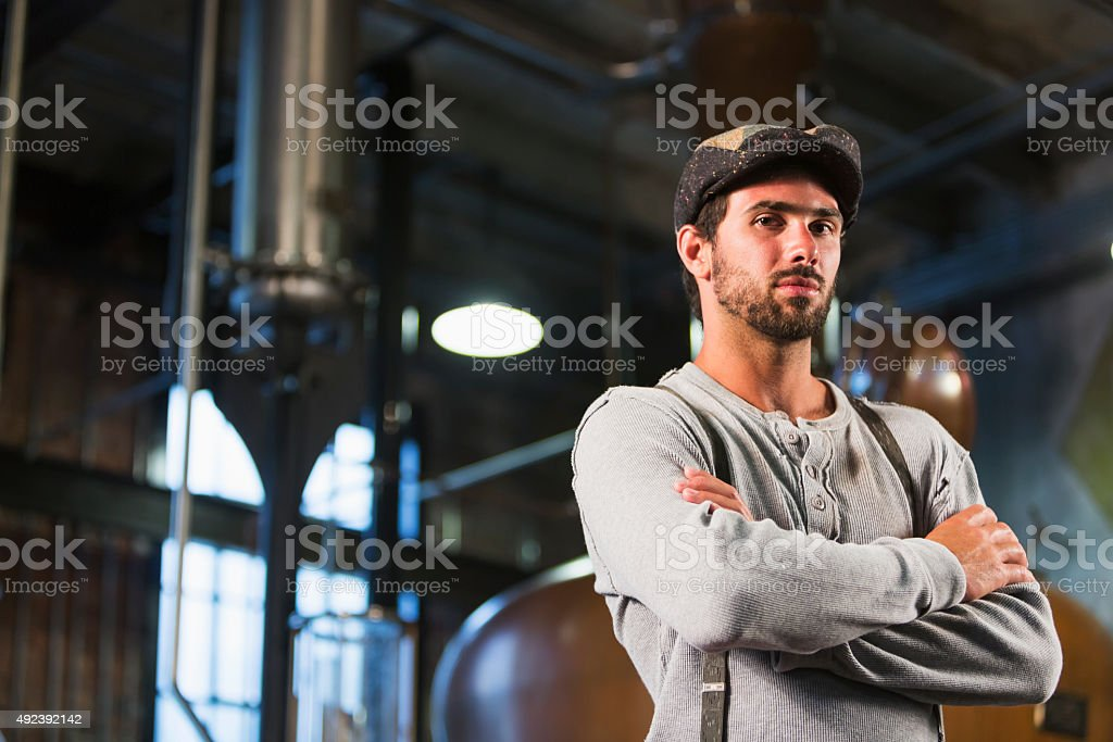 Man working in old distillery stock photo