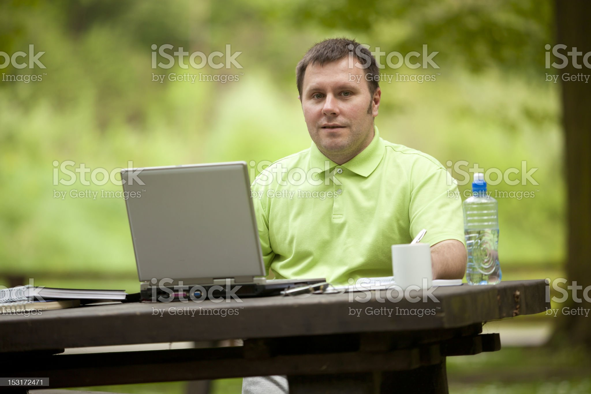 Man Working in Open Green Office royalty-free stock photo