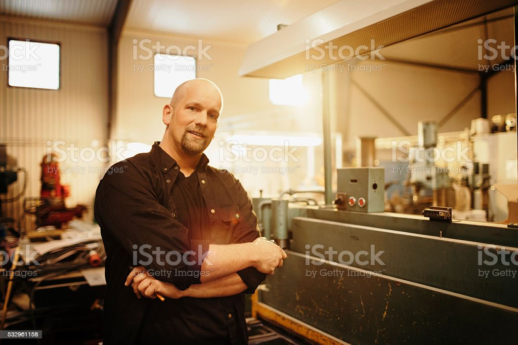 Man working in production stock photo