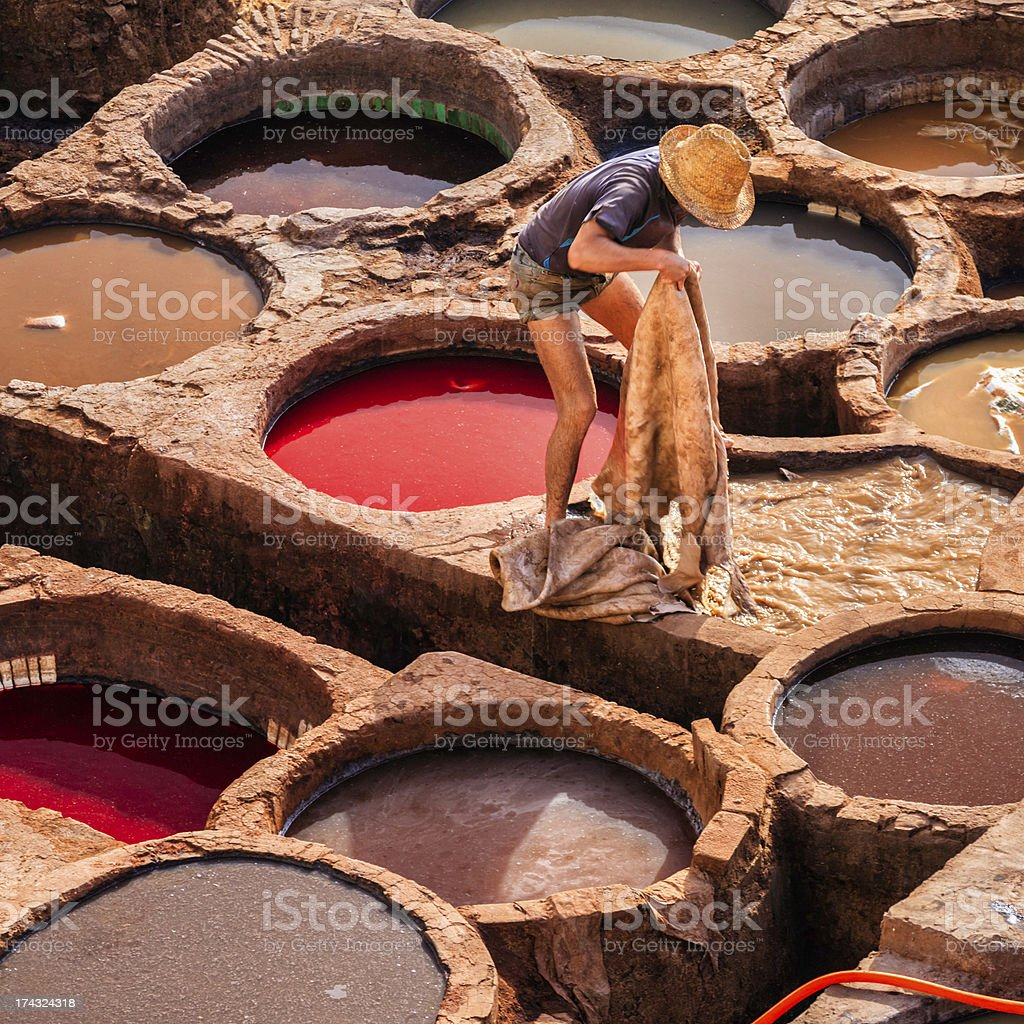 Man working in the tannery, Fez, Morocco stock photo