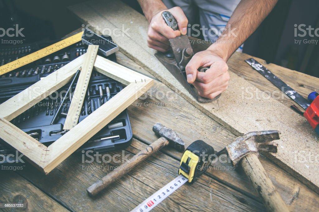 man working in wood stock photo