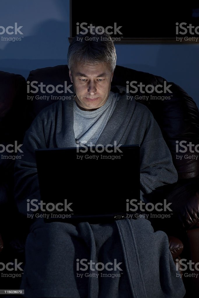 Man working late on a laptop from home royalty-free stock photo