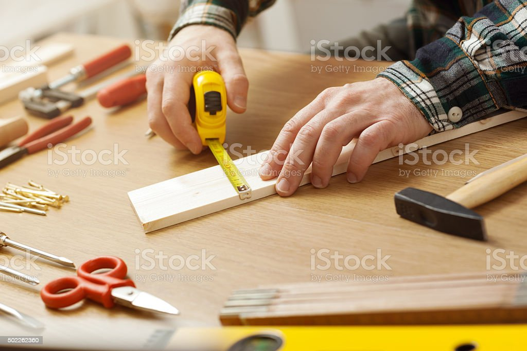 Man working on a DIY project stock photo