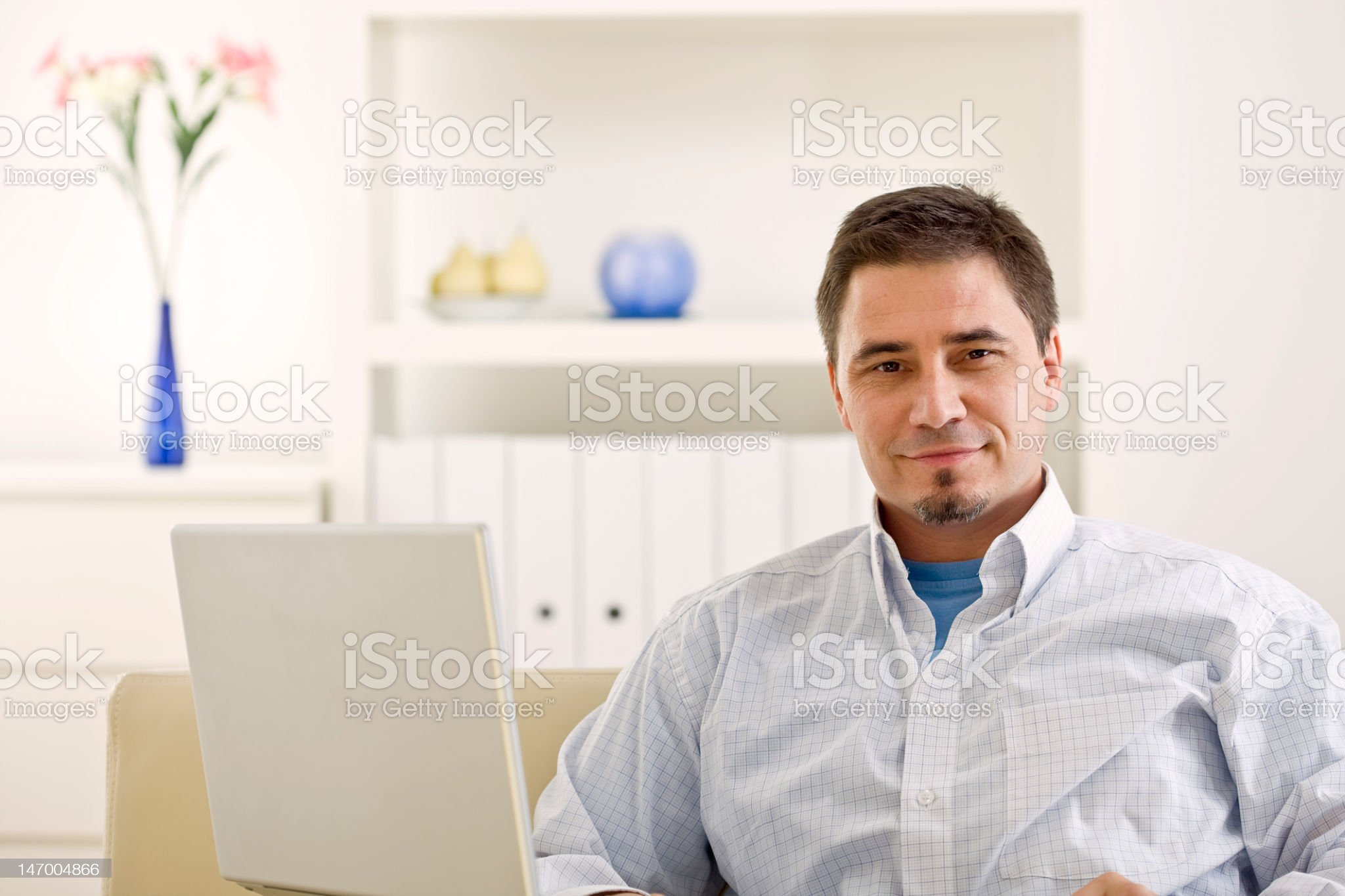 Man working on a laptop and smiling royalty-free stock photo