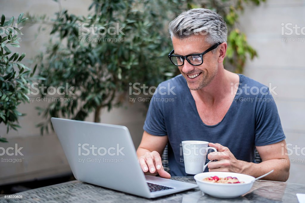Man working on a laptop stock photo