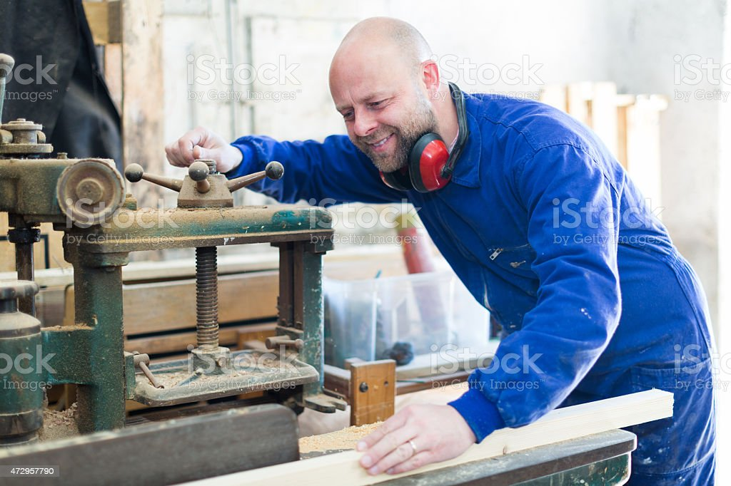 Man working on a machine at workshop stock photo