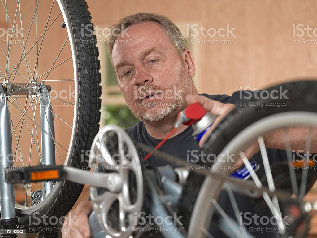 Man working on Bicycle royalty-free stock photo