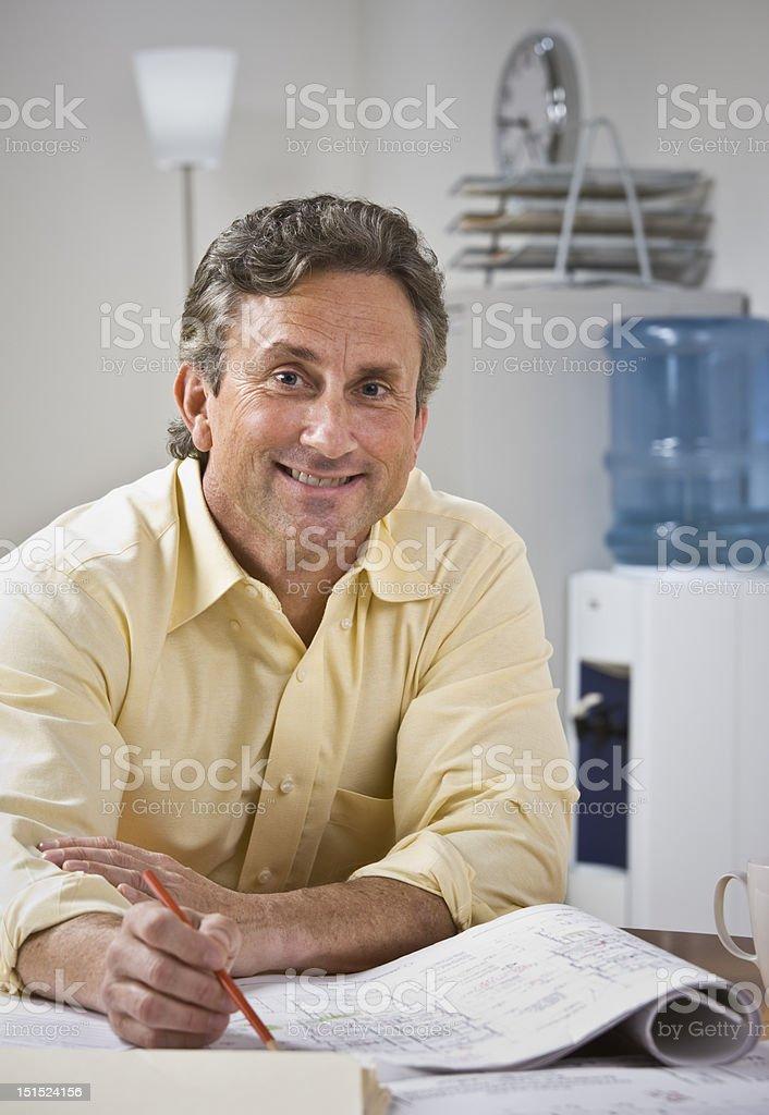 Man Working on Blueprints royalty-free stock photo