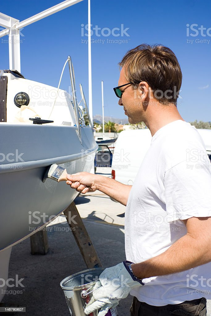 Man working on boat. royalty-free stock photo