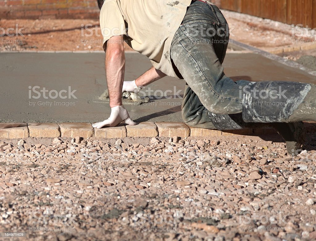 Man working on concrete with a planer royalty-free stock photo