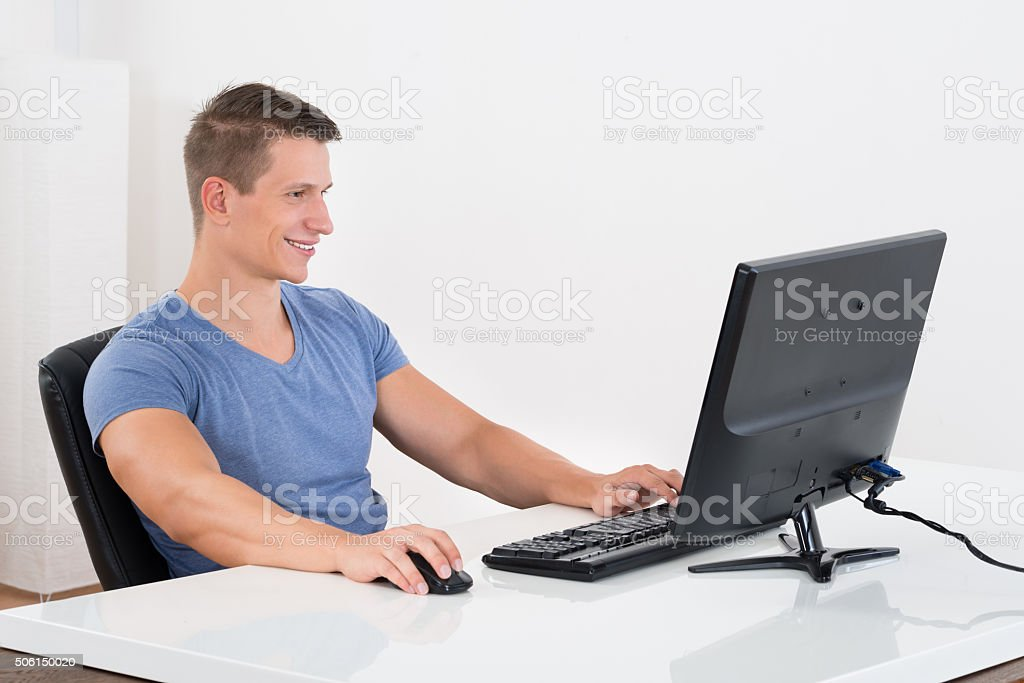 Man Working On Desktop Computer stock photo