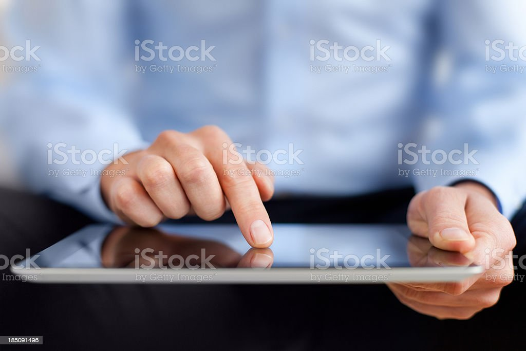 Man working on digital tablet royalty-free stock photo