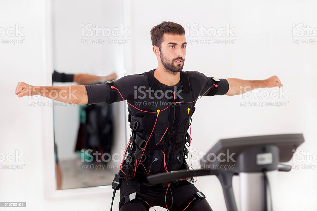 man working on electro muscular stimulation machine stock photo