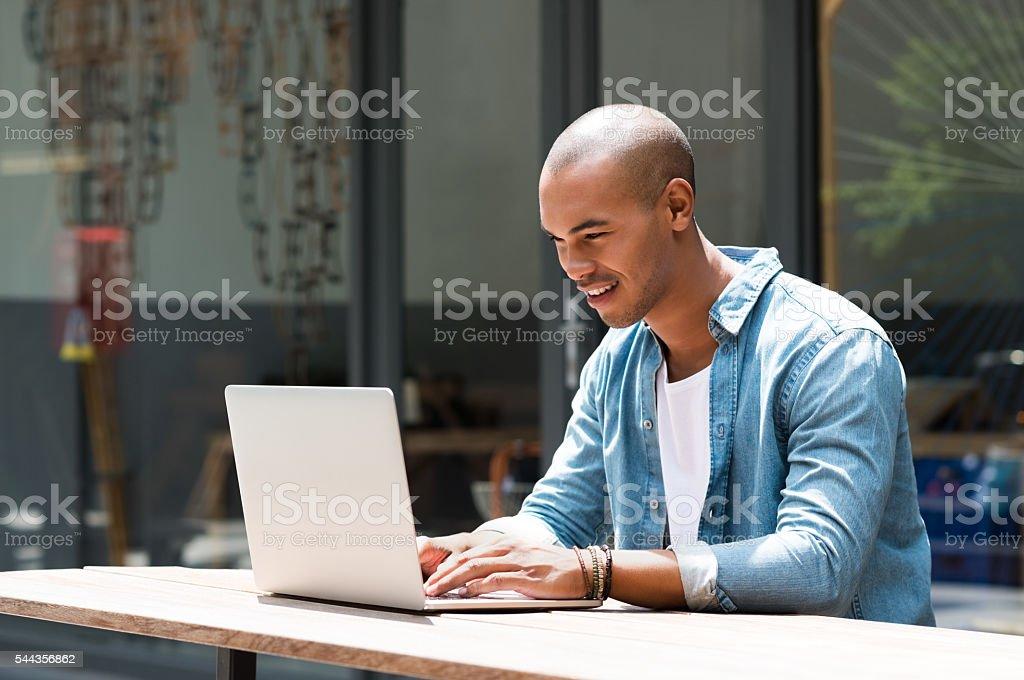 Man working on laptop stock photo