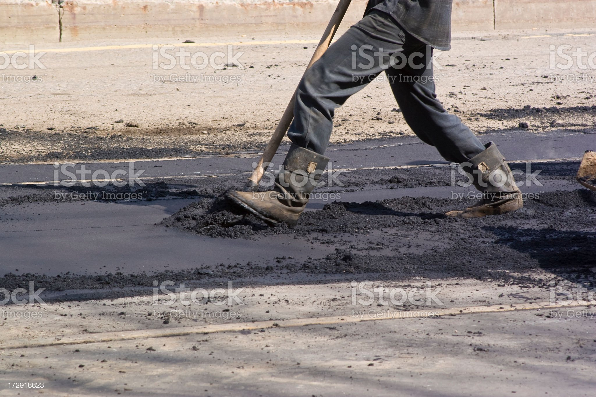 Man working on reconstructing road. royalty-free stock photo