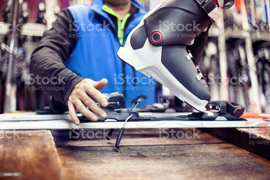 Man working on skis stock photo