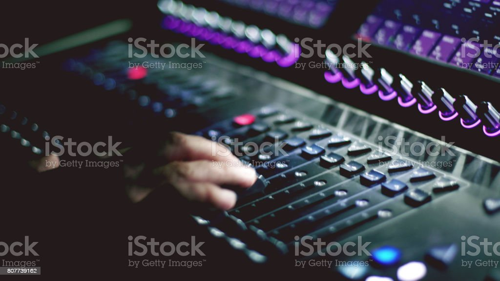 Man working on sound mixer in the club stock photo