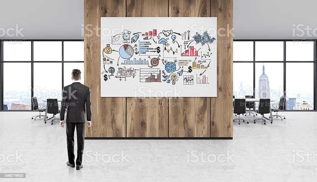 Man working on strategy stock photo